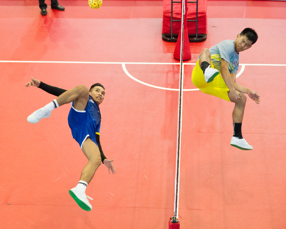 A Laotian player prepares to spike during the sepak takraw competition of the ASEAN University Games at the Bedok Sports Hall.
