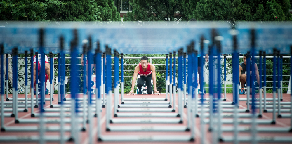 A Singaporean hurdler looks through the hurdles during the 110m hurldes competition of the ASEAN University Games at the Chua Chu Kang Stadium.