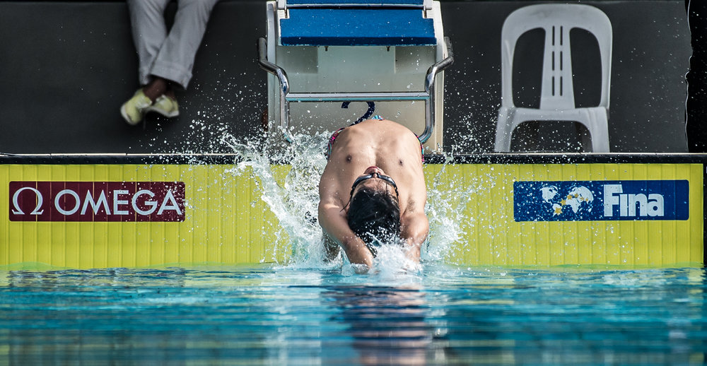 A Singaporean swimmer in action during the swimming competition of the Singapore National Games at the Toa Payoh Swimming Complex.