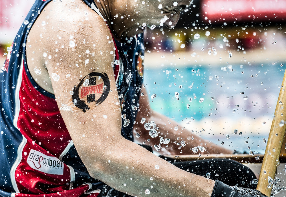 The competition logo on the arm of a racer during the Dragon Battle Asia competition at the Orchid Country Club.