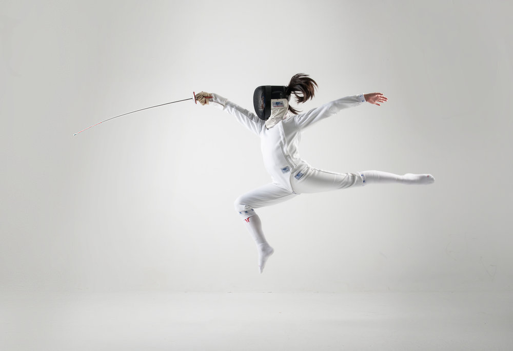 A fencer lunges in the Studio