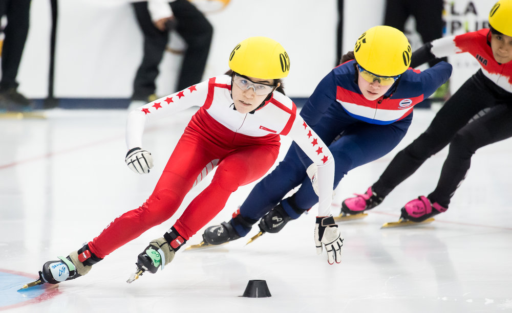 Singaporean, Thai and Indonesian speed skaters in action during the SEA Games at the Empire City Skating Rink.