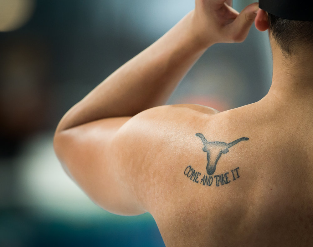 A Singaporean swimmer puts on his googles during the SEA Games at the National Aquatic Centre, Bukit Jalil.