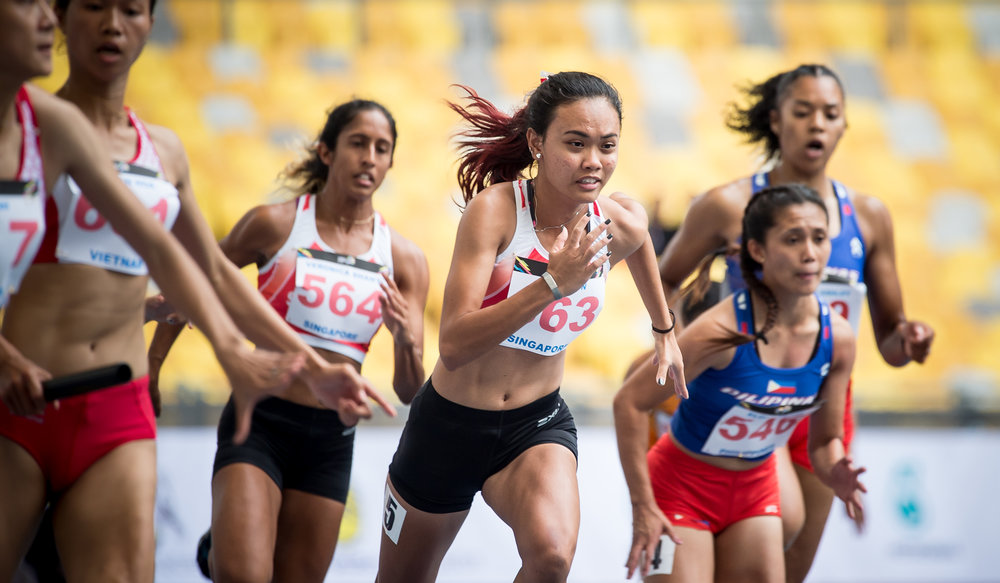A Singaporean sprinter in action during the SEA Games at the Bukit Jalil Stadium.