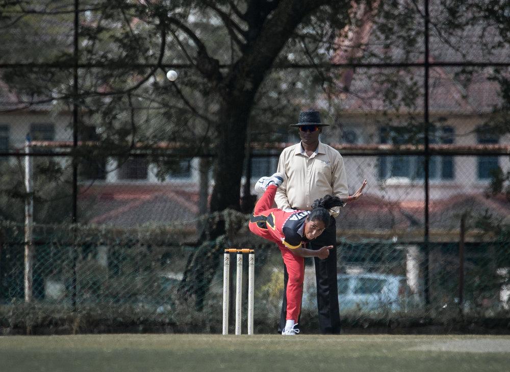 A Singaporean cricket player bowls during the SEA Games at the Kinrara Oval.