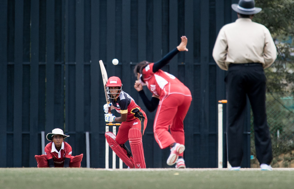 A Singaporean cricket players bats during the SEA Games at the Kinrara Oval.