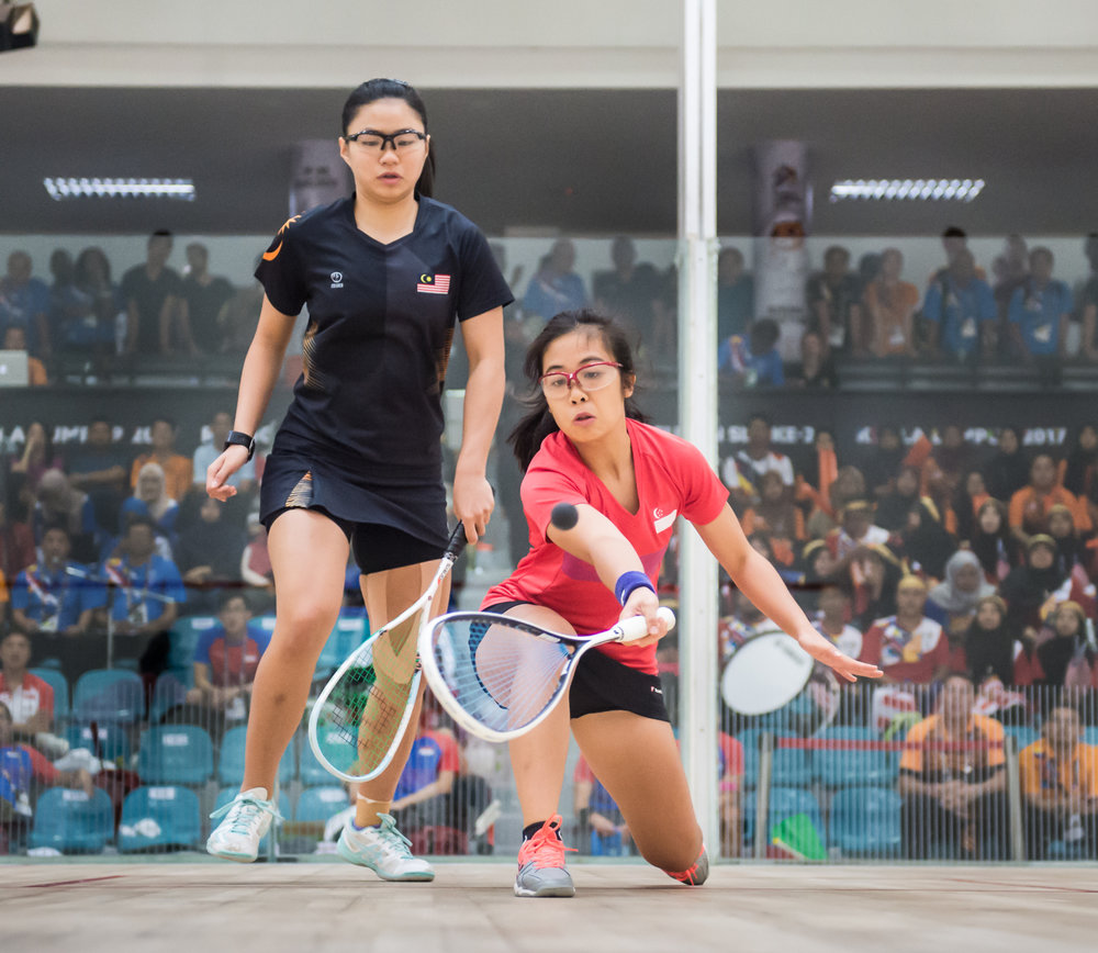 A Singaporean squash player in action during the SEA Games at the National Squash Centre, Bukit Jalil.