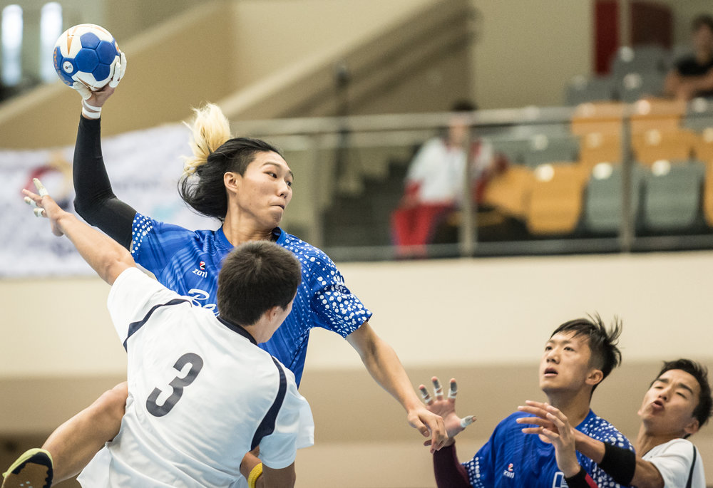 A Hong Kong player prepares to score during an international hand ball match at Our Tampines Hub.