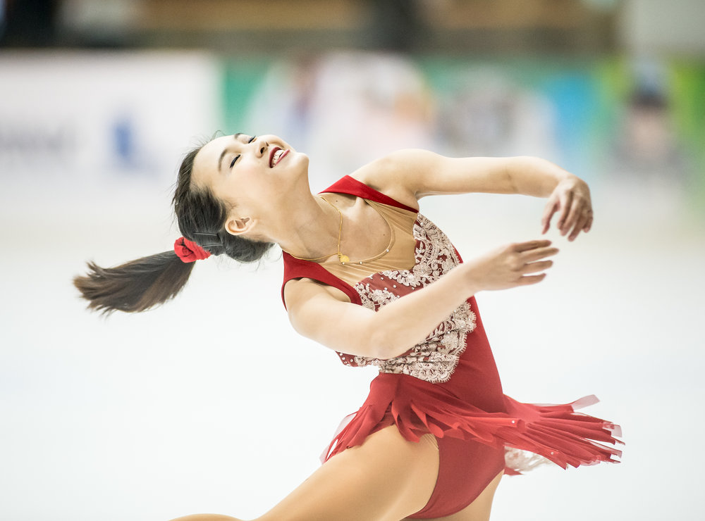 A figure skater executes a spin during the Singapore National Championships at the Rink.