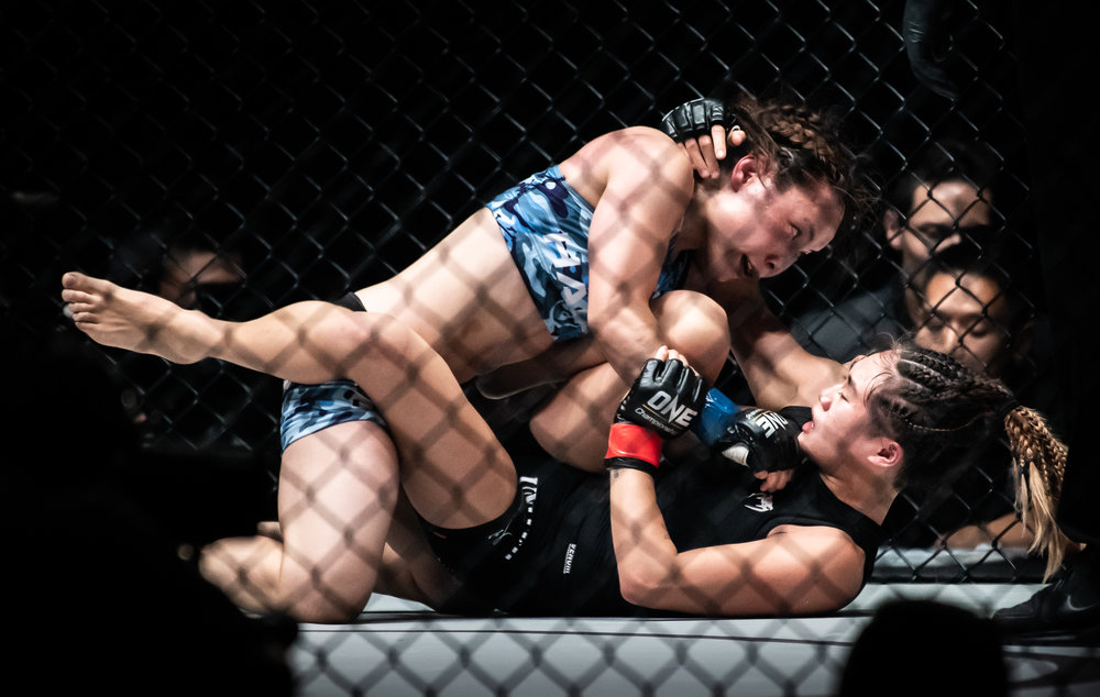 A Japanese and Singaporean opponent during a One Championship World Title match at the Singapore Indoor Stadium.