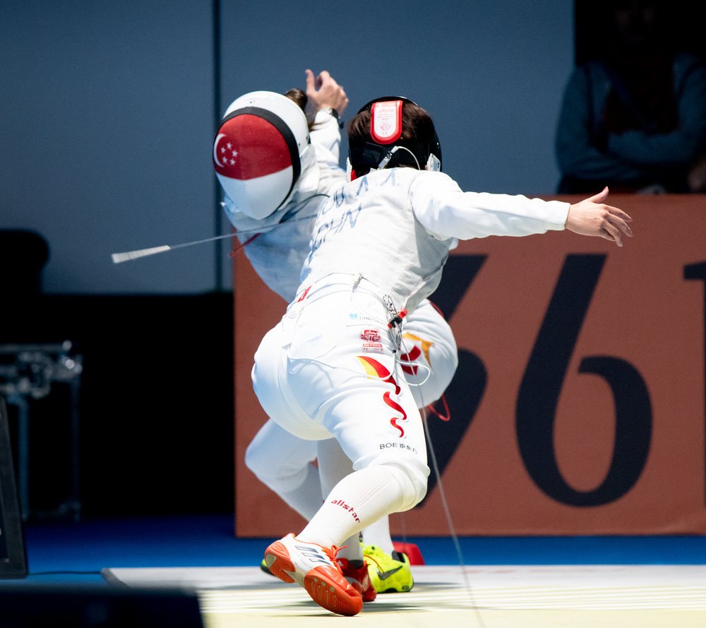 A Singaporean fencer during her women's foil event of the Asian Games at the Gelora Bung Karno Sports Complex.