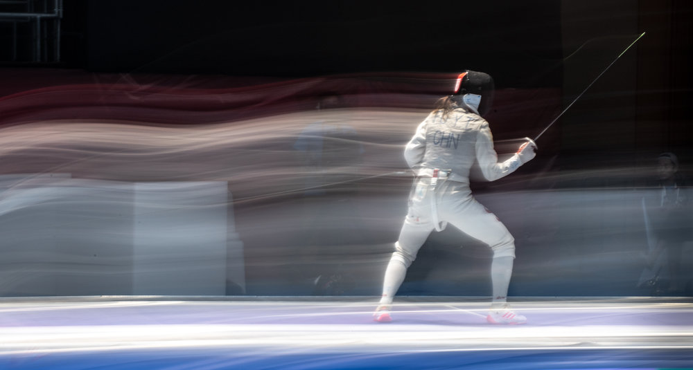 A Chinese fencer in action during the foil team finals of the Asian Games at the Jakarta Convention Centre.