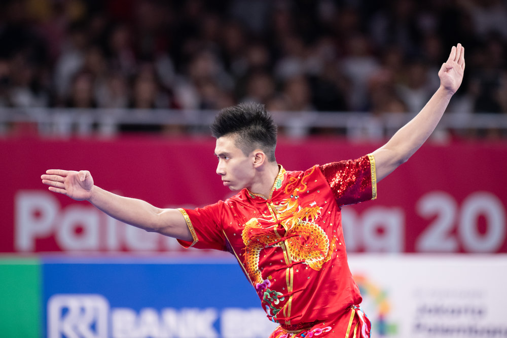 A Singaporean wushu exponent during the Men's Changquan event of the Asian Games at the Jakarta International Expo.