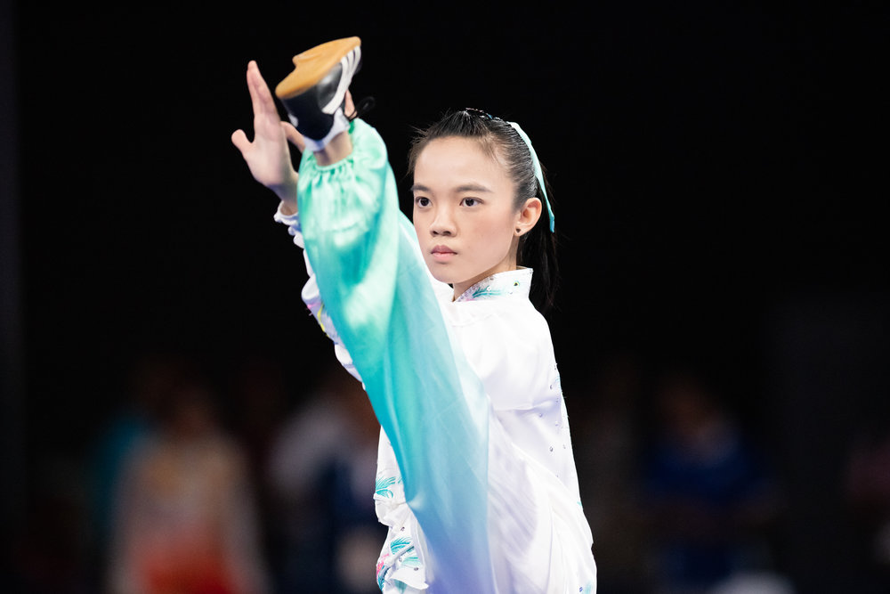 A Singaporean wushu exponent during the Women's Taijiquan event of the Asian Games at the Jakarta International Expo.