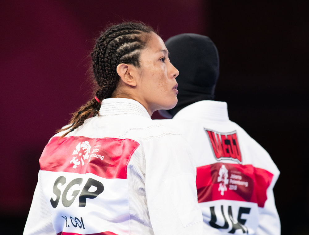 A Singaporean Jiu Jitsu exponent and her United Arab Emirates opponent during the Asian Games at the Jakarta Convention Centre.