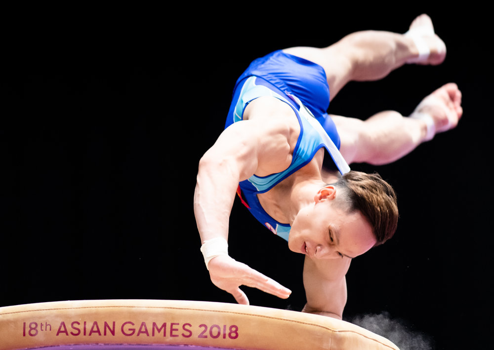 A Vietnamese gymnast during the Men's Artistic Gymnastics Qualifiers of the Asian Games at the Jakarta Convention Centre.