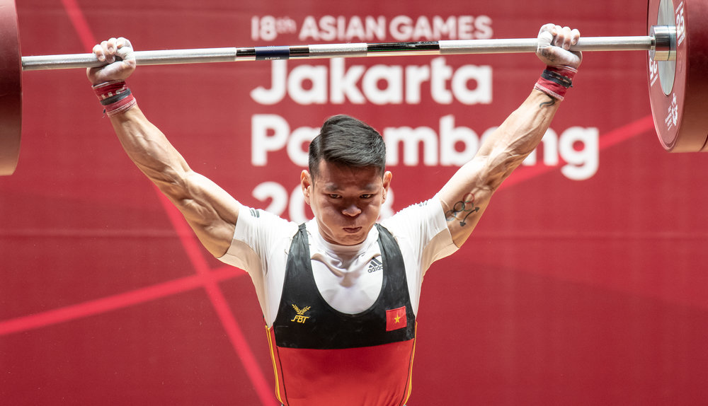 A Vietnamese weightlifter during the men's 56kg event of the Asian Games at the Jakarta International Expo.