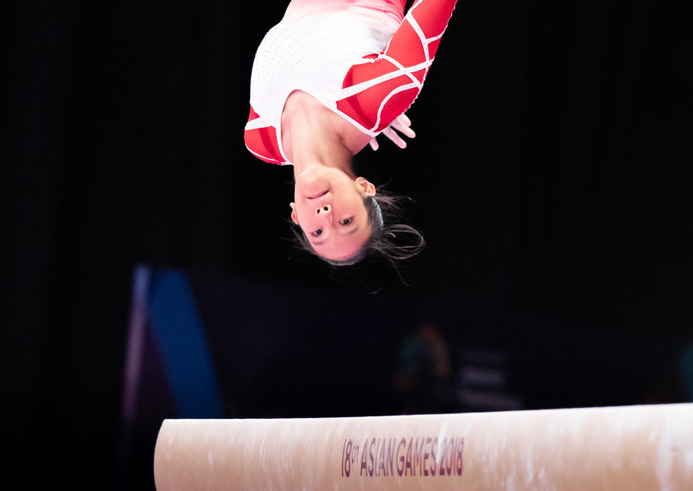 A Singaporean gymnast during the Women's Artistic Gymnastics Qualifiers of the Asian Games at the Jakarta Convention Centre.