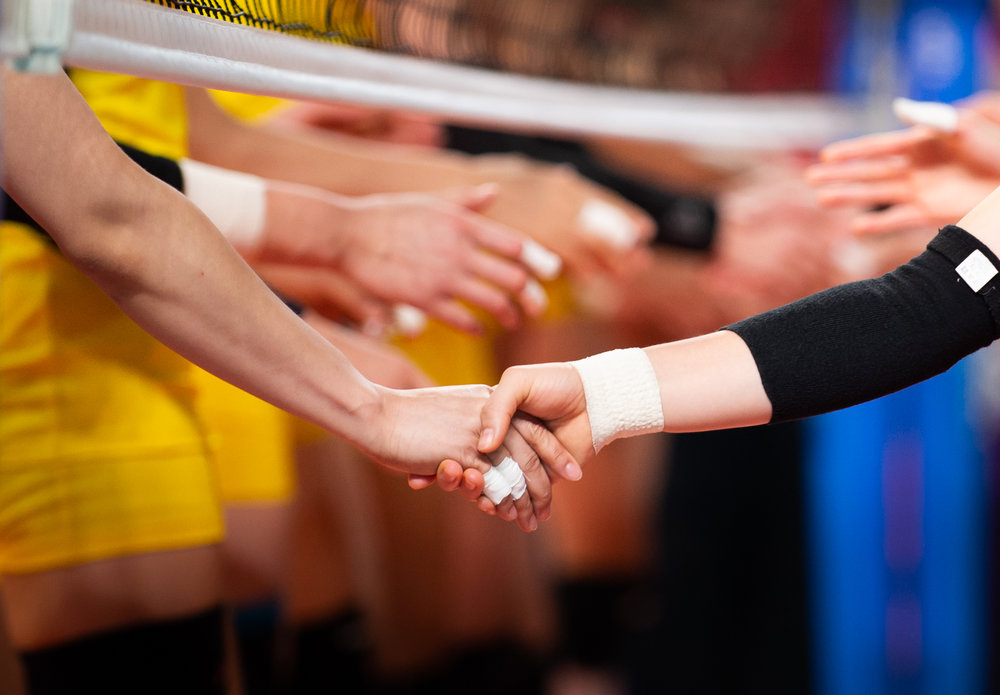 Vietnamese and Korean players shake hands before the Women's Volleball match of the Asian Games at the Gelora Bung Karno Sports Complex.