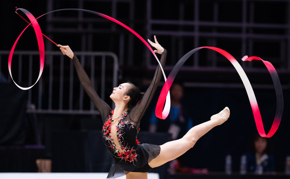 A Chinese Gymnast during her Ribbons routine of the Asian Games at the Jakarta Convention Centre.