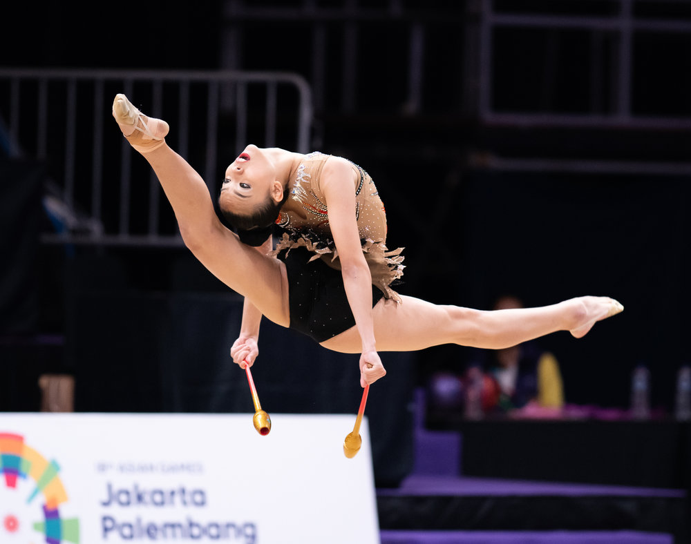 A Malaysian Gymnast during her Clubs routine of the Asian Games at the Jakarta Convention Centre.