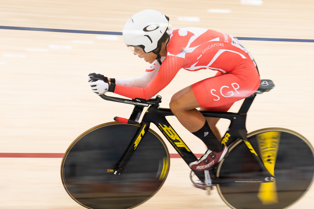 A Singaporean cyclist during the Asian Games at the Jakarta Velodrome.