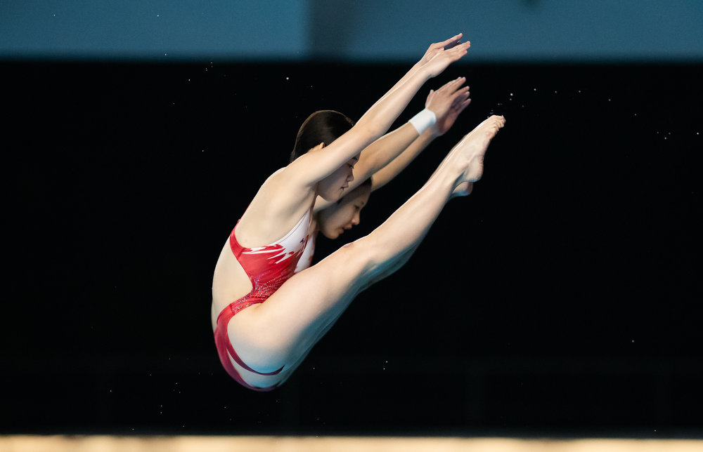 Chinese divers during the 10m Synchronized Platform Final of the Asian Games at the GBK Aquatic Centre.