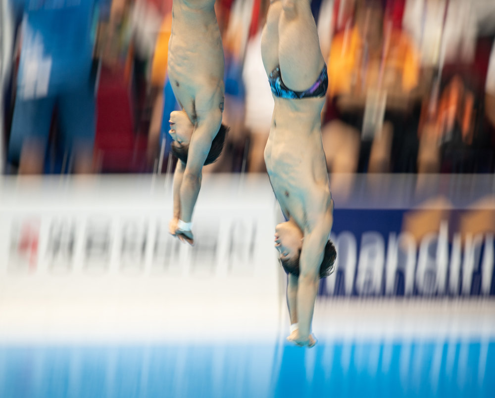 Korean divers during the 3m Synchronized Springboard Final of the Asian Games at the GBK Aquatic Centre.