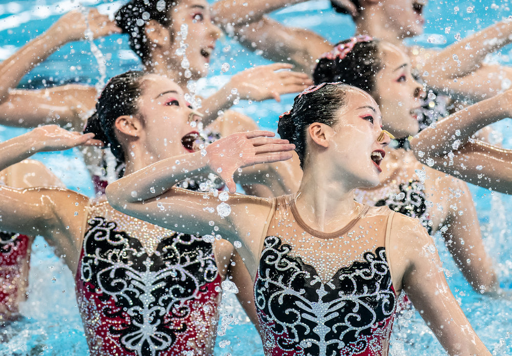 Chinese swimmers during their technical routine of the Asian Games at the GBK Aquatic Centre.