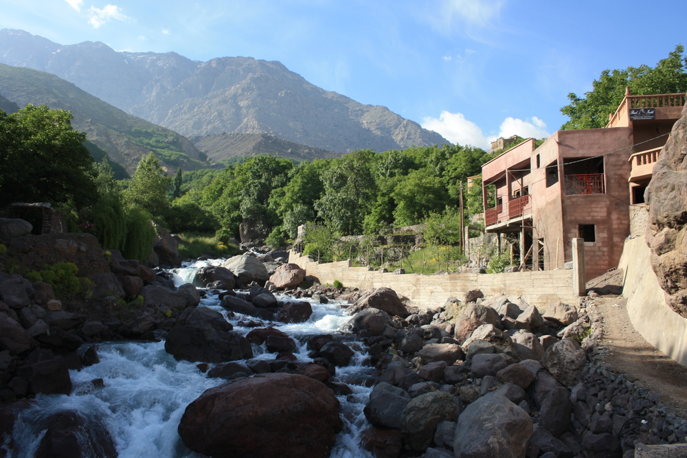 A waterfall cascades through the town of Imlil
