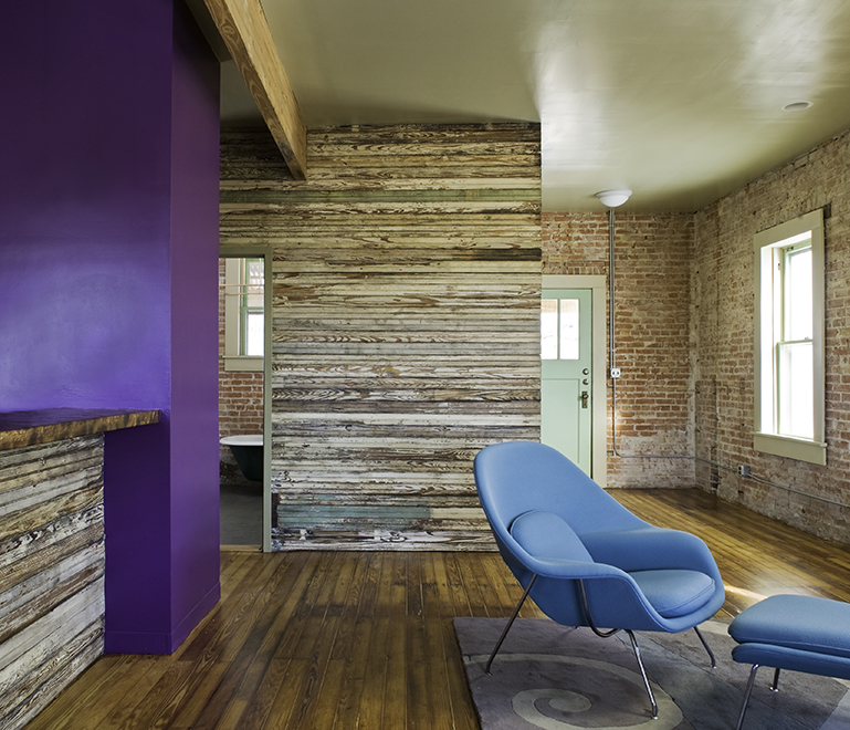 "Living room with salvaged bead-board siding, residential loft, ""El Picoso"", San Antonio, Texas, 2008. Photo by Chris Cooper Photography"