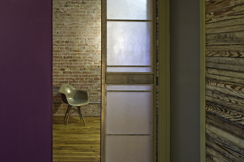 "Aluminum and acrylic sliding door panel, residential loft, ""El Picoso"", San Antonio, Texas, 2008. Photo by Chris Cooper Photography"