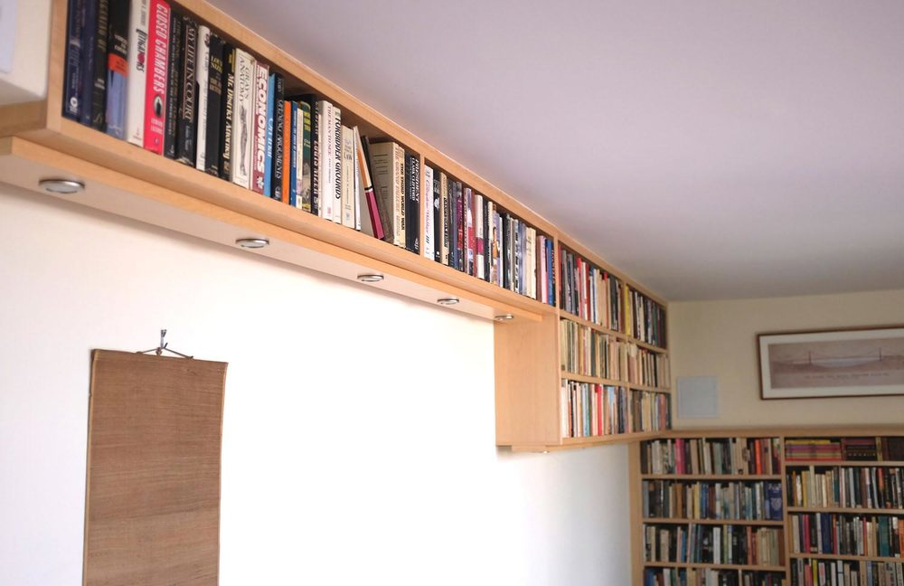 Shelves wrap around the corner.