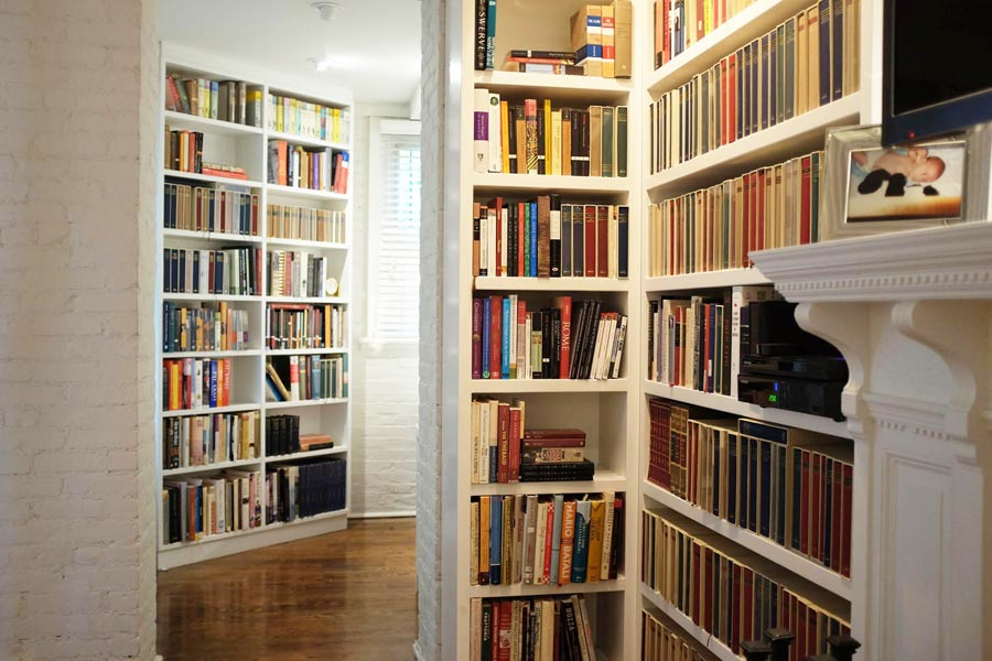Custom bookshelves wrap the corner of this hallway.