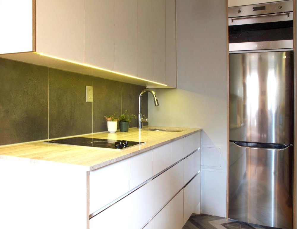 Strip lights were installed underneath the upper cabinets to illuminate the countertop.