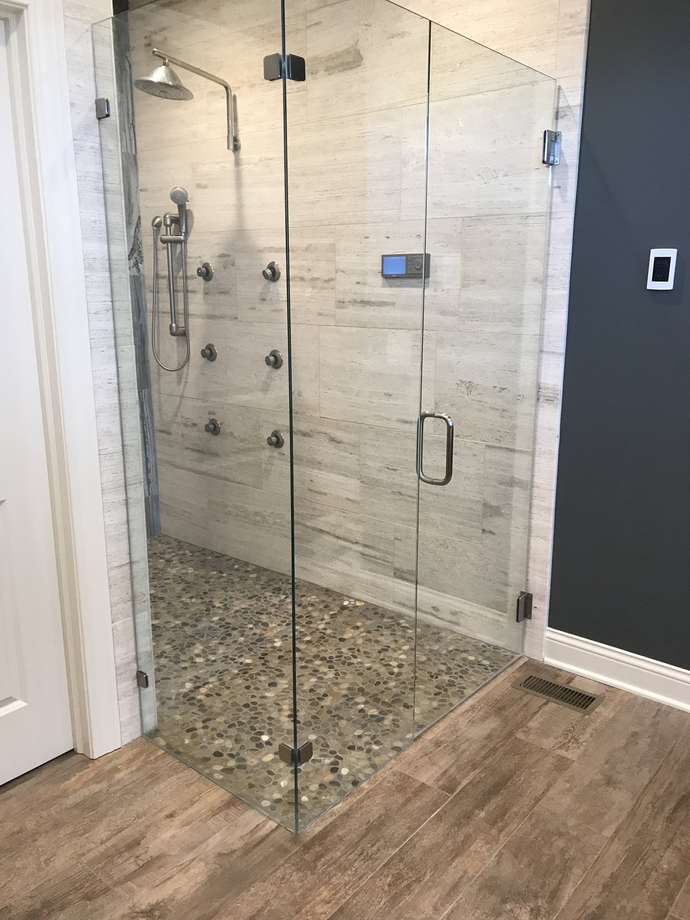 One of our bathroom remodels where we created a curb less walk in shower.