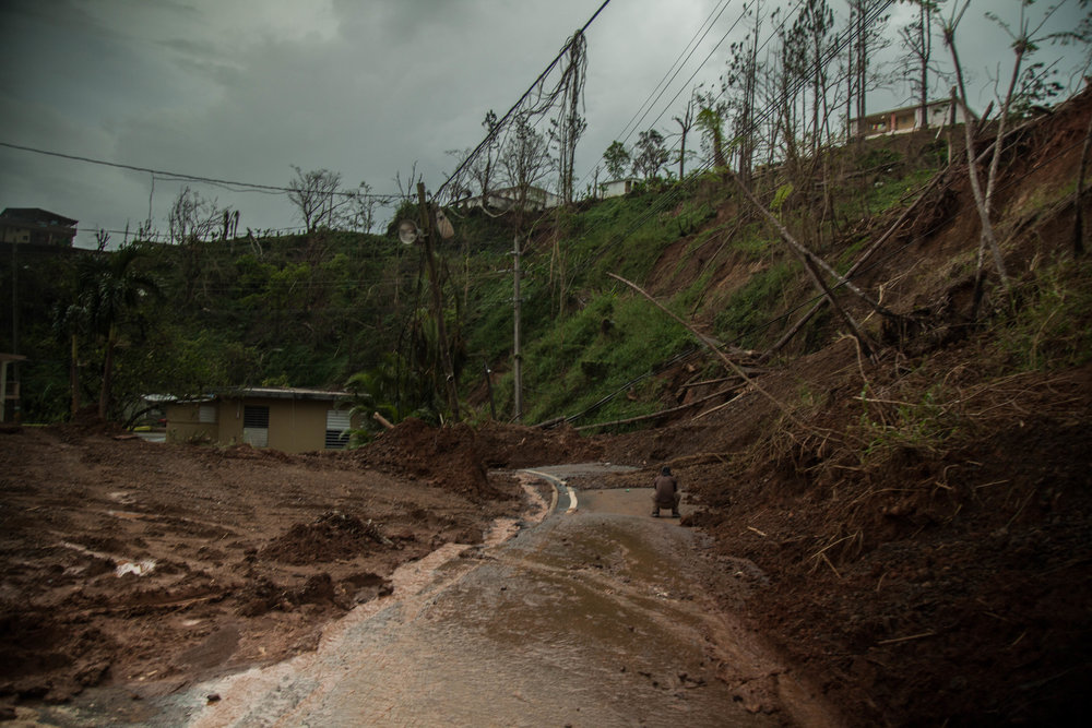 Landslide in Barranquitas obstructing passage of vehicles.