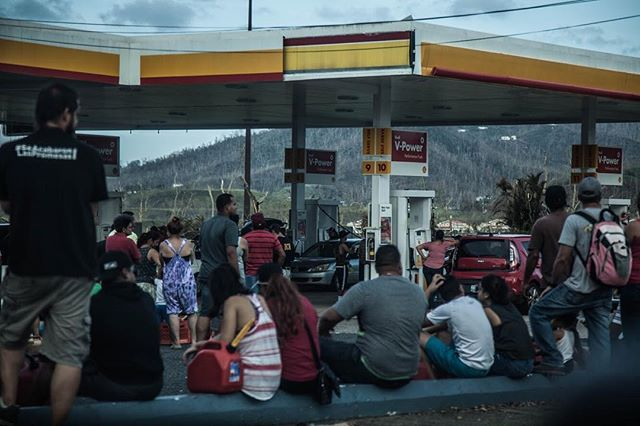 People line up waiting to fill up their gas cans with what little remains. Only days after the hurricane hit Puerto Rico. . . . . #blog #puertorico #photo #hurricane #hurricanemaria #whatsleftover #gas #aftermath #photography #travel #home #puertoricolove #help #hurricanehelp #canonphotos #sustainability #canon #canon5dmarkii #rebuild