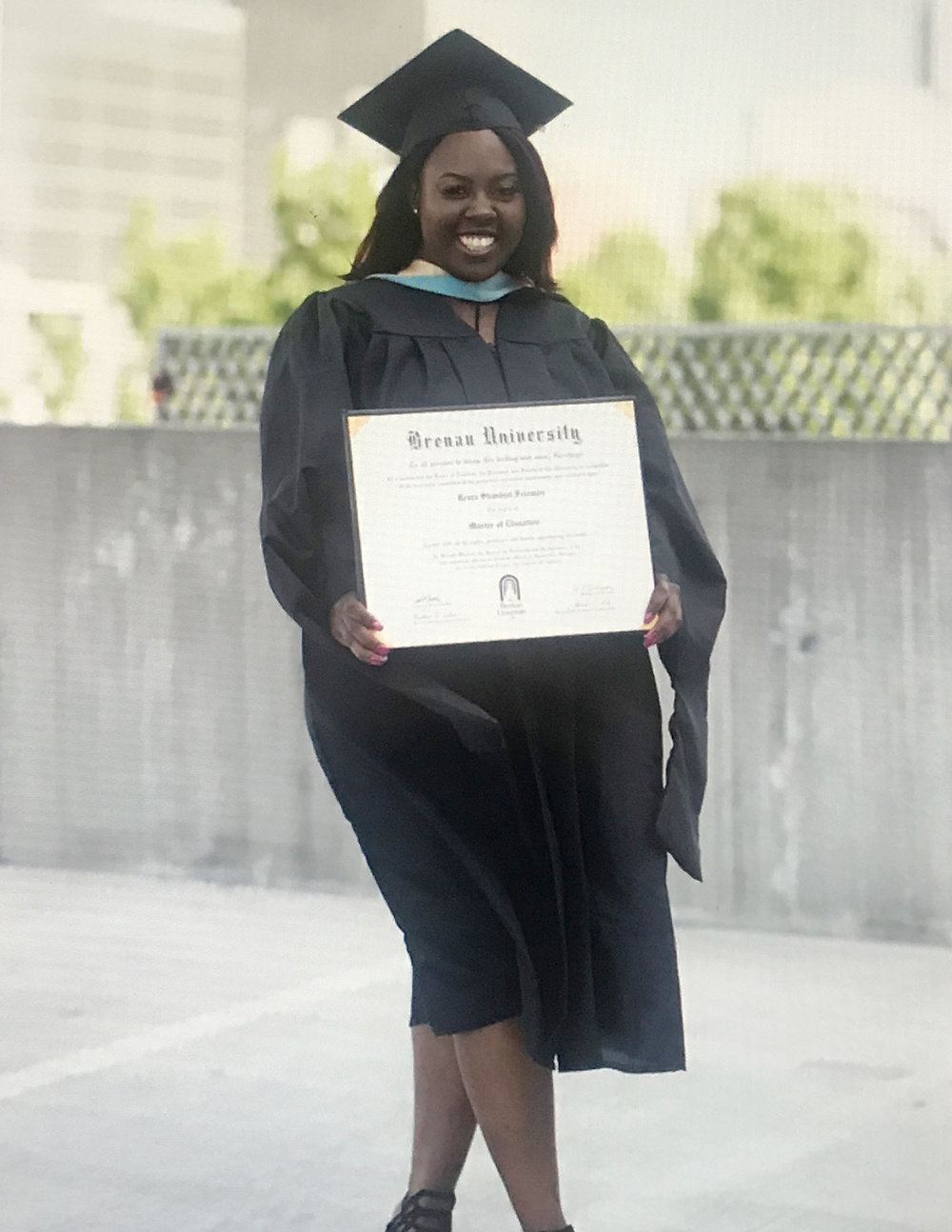 Renea Freeman, BGCNCG Social Circle Club Alumni member, after her recent graduation, in which she obtained her Masters in Early Childhood Education.