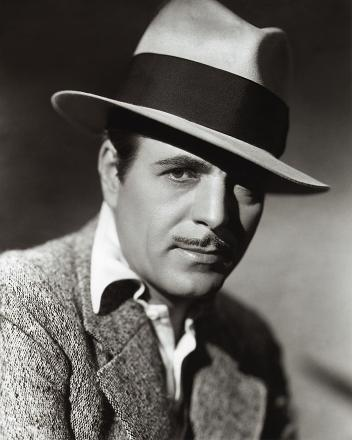 Warner Baxter - A pencil mustache was the fad, and man did it look good with that fedora.