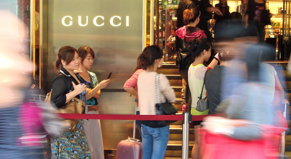 Chinese consumers lining up to purchase premium branded goods. Source: MarketWatch