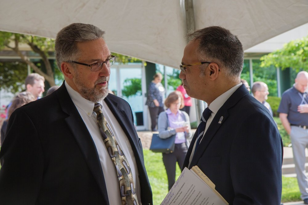 PROSOCO and Build SMART CEO and President David Boyer (left) speaks with Kansas Secretary of Commerce Antonio Soave (right) speak at the Solar Works celebration on April 18, 2017. Photo courtesy PROSOCO.
