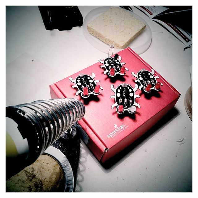 Teaching basic soldering to neighborhood kids.