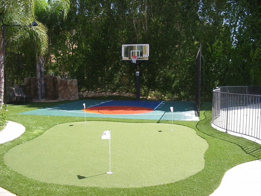 Low maintenance landscape with Sport Court
