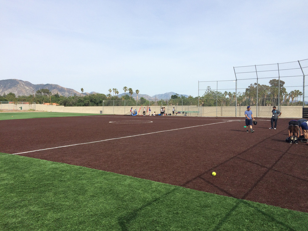 Synthetic artificial grass baseball field