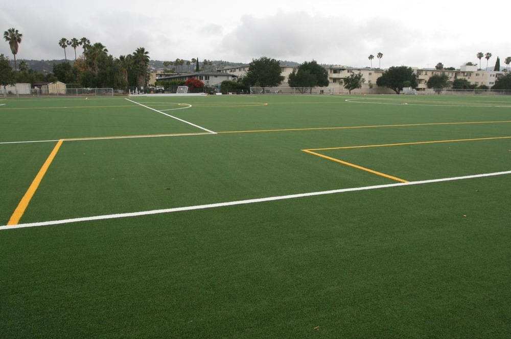 Synthetic artificial grass soccer field