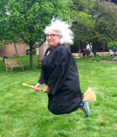 Assistant Hogwarts Headmistress circling the perimeter of the Quidditch pitch