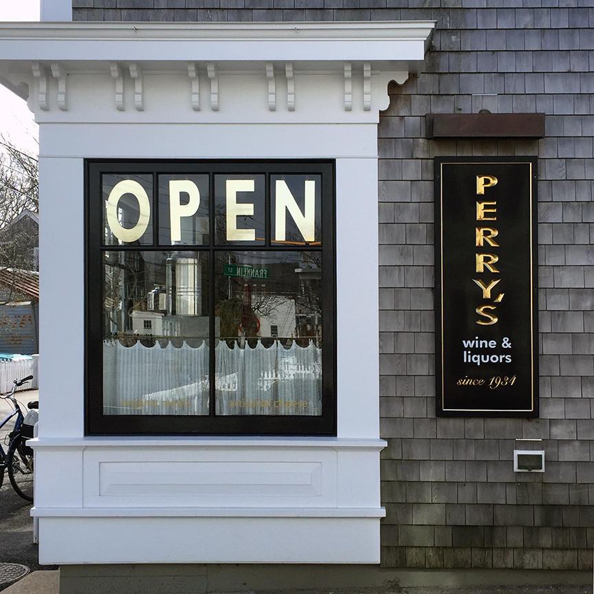 """The famous """"OPEN"""" sign heralds all of Provincetown to a unique selection of wine, spirits and delicious provisions."""