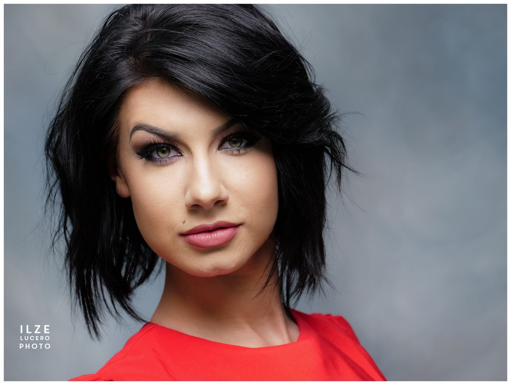 Color  -  bold headshot of beautiful woman with dark hair anf great makeup
