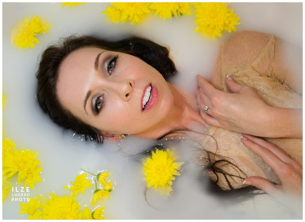 Beautiful brunette milk bath photo shoot with yellow flowers